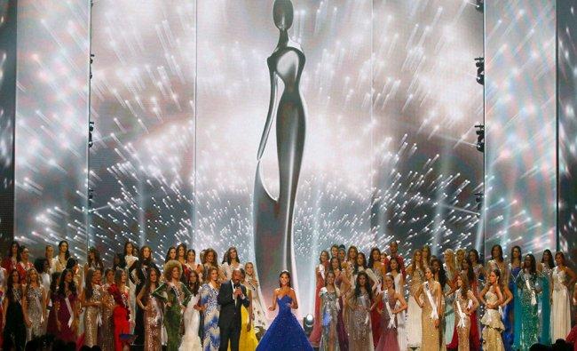Miss Universe 2015 Pia Wurtzbach, center, bids farewell after ending....
