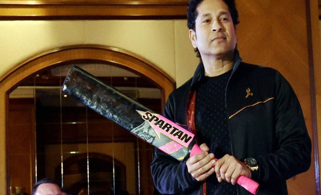 Former Indian captain Sachin Tendulkar poses for a photo during...