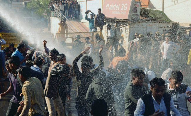 Police using water cannon to disperse the NSUI activists, holding protest, in Jabalpur...