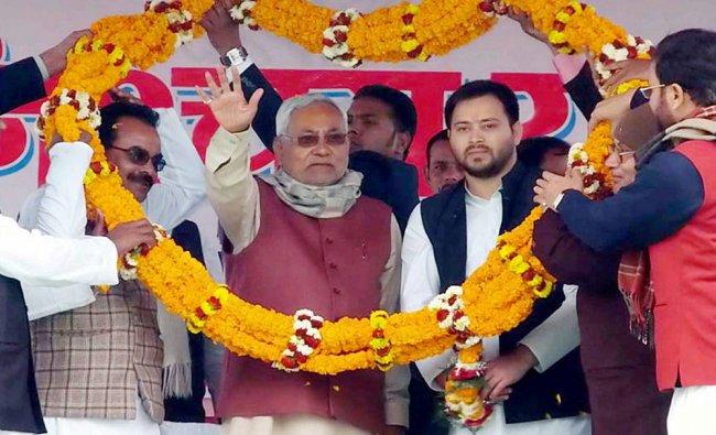 Bihar Chief Minister Nitish Kumar with deputy CM Tejaswi Yadav being garlanded during his Nischay ..
