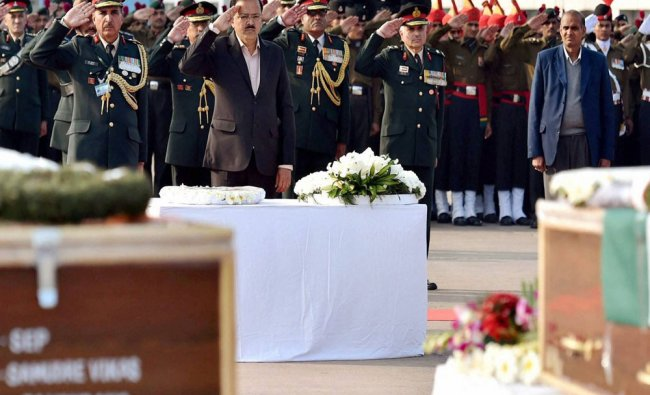 MoS for Defence Subhash R Bhamre paying homage at the coffins of their colleagues killed in the ...
