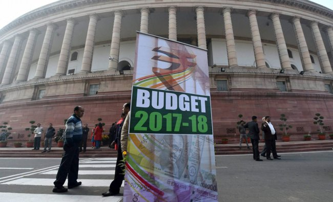 A hoarding on Central Budget 2017-18 put up at Parliament house in New Delhi on the day...