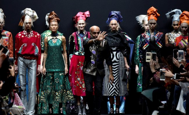 Indian fashion designer Manish Arora waves to the audience after his Fall-Winter 2017-2018 ready...