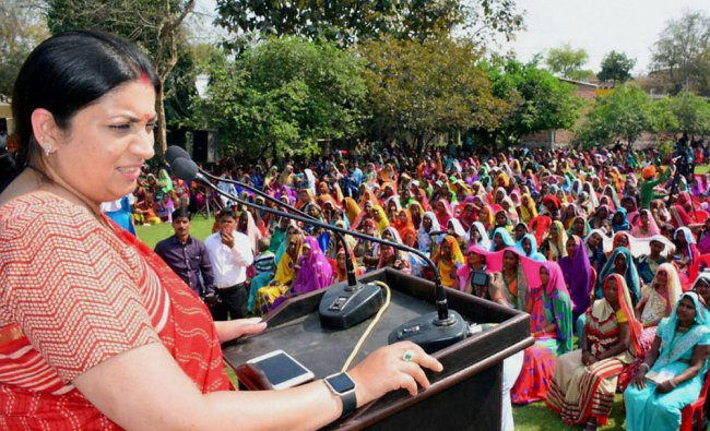 Union minister for Textiles Smriti Irani addresses an election rally in Varanasi on Thursday...