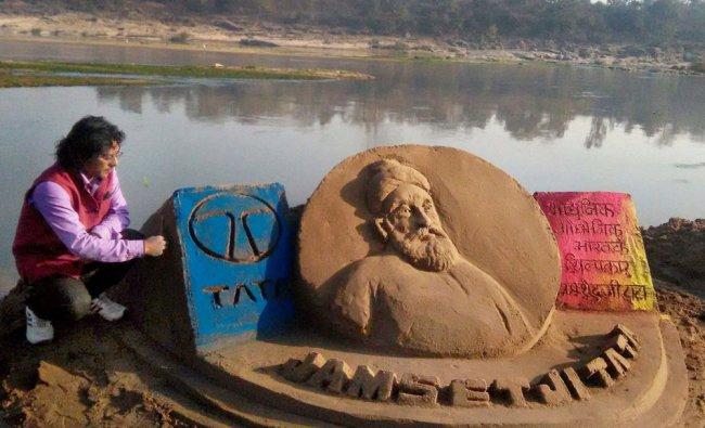 Artist Ajay Shankar with his sand sculpture to mark birth anniversary of Jamsetji Tata...