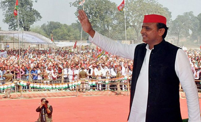 Uttar Pradesh Chief Minister Akhilesh Yadav waves at people during an election rally in Ballia...
