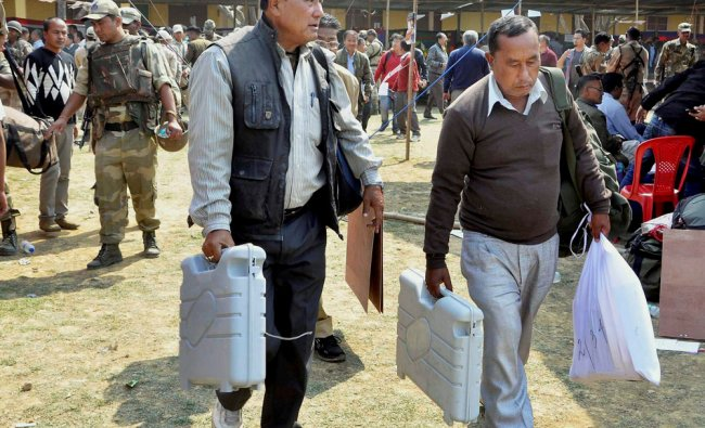 Officials leave for election duty on the eve of voting for the Assembly polls at Porompat, Imphal...