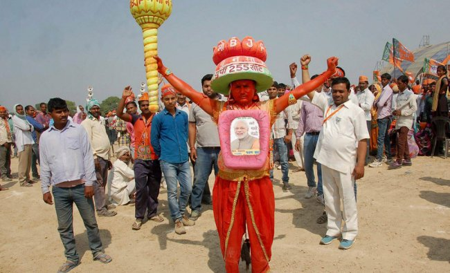 A supporter at Prime Minister Narendra Modi\'s election campaign rally in favour of BJP candidates...