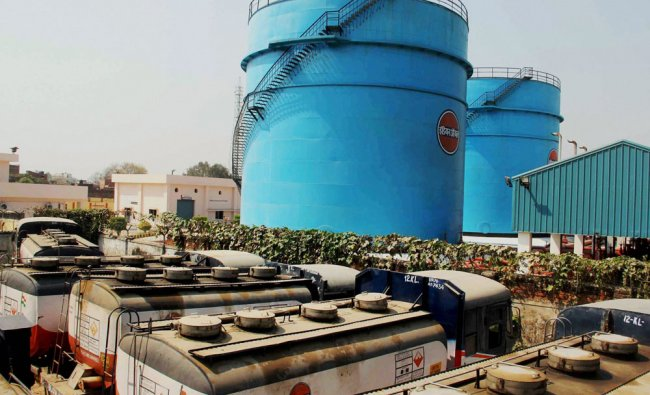 Oil tanker trucks stand outside an Indian Oil Corporation depot at Subedar Ganj, as a strike...