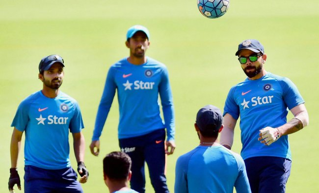Indian cricket team captain Virat Kohli plays football with team mates during a practice session...