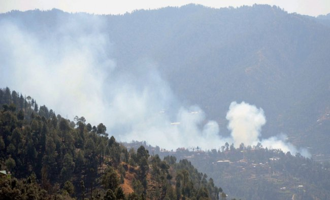 Smoke arising after a major fire broke out at Mehali in Shimla...