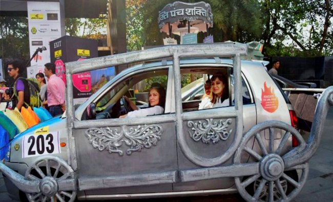 Women participate in All Womens Rally in painted and colourful cars to mark International...