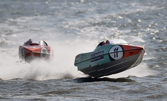 Teams compete during powerboat racing event at the Marine Drive in Mumbai...