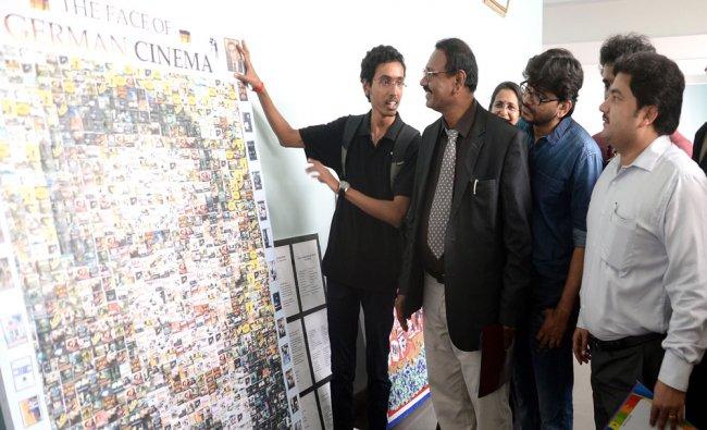A student explaining the poster to Vice Chancellor of Bangaluru University Jagadish Prakash...