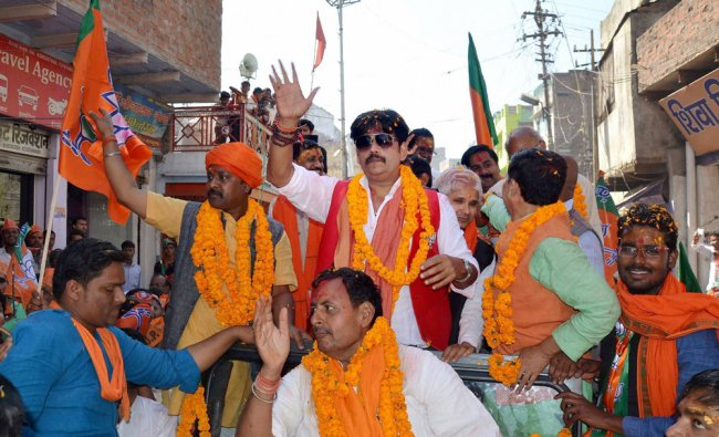 Bhojpuri actor Ravi Kishan, who recently joined BJP, during an election road show in favour of party