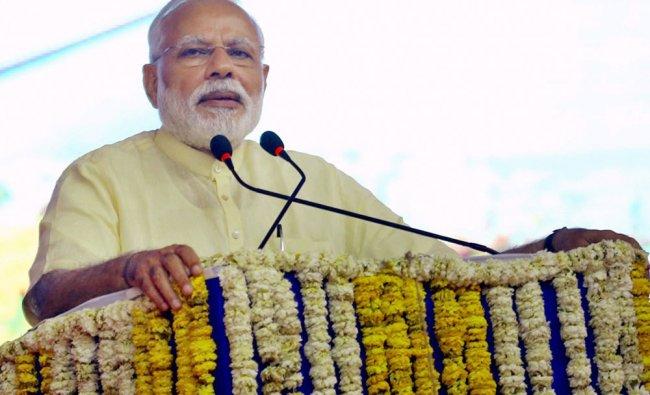 Prime Minister Narendra Modi addresses during the dedication ceremony of a Four-Lane Extradosed...