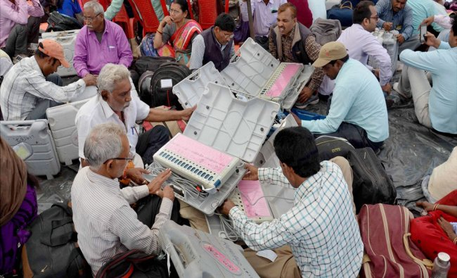 Polling officers checking Electronic Voting Machines before leaving for election duty...