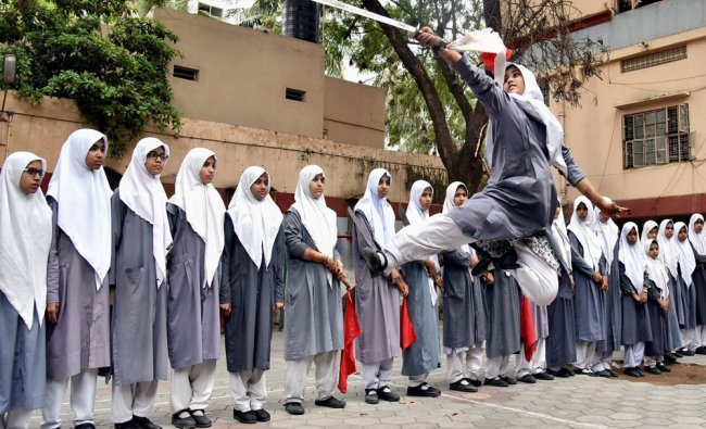 Girl students performing a Vietnamese martial art on the eve of International Womens day...