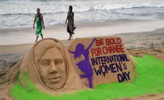 Sand artist Manas Sahoo makes a sand art on the eve of International Women\'s Day in Puri beach...
