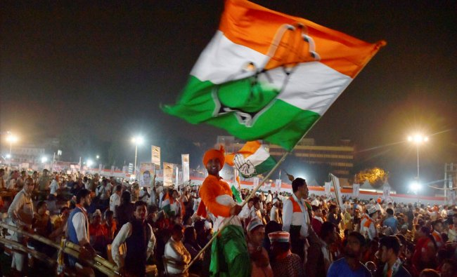 A Congress worker waves party flag during the DPCC workers convention...
