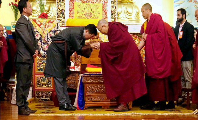 Prime Minister of the Tibetan government-in-exile Lobsang Sangaye greets spiritual leader...