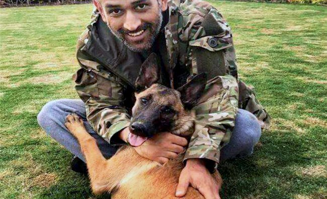Indian Cricketer Mahendra Singh Dhoni with his dog at his residence in Ranchi ...