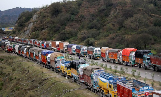 Vehicles stranded on Jammu-Kashmir National Highway after the road was blocked due to heavy...