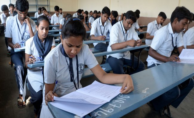 Students writing their PUC exams at the Vidyavardhaka College center, in Bengaluru...