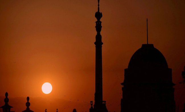 A view of the setting sun as seen over Rashtrapati Bhavan in New Delhi...