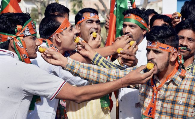 BJP supporters celebrate as early trends show the party\'s thumping win in the UP Election Results...