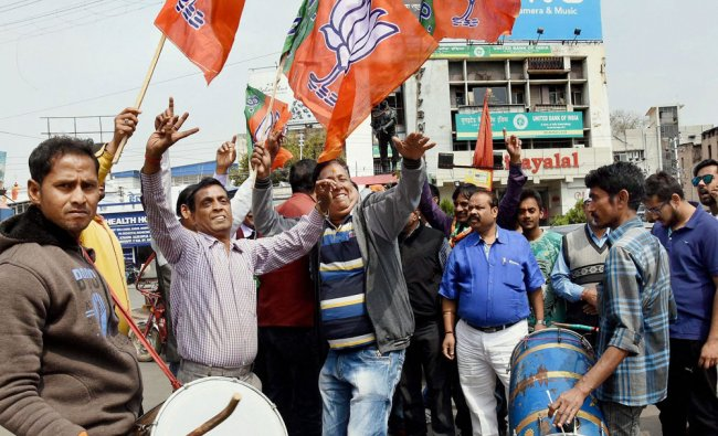 BJP supporters celebrate the party\'s sweep in Uttar Pradesh and Uttarakhand Assembly elections ...