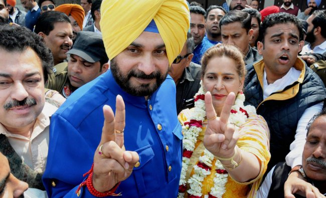 Congress candidate from Amritsar East assembly constituency Navjot Singh Sidhu with his wife ...