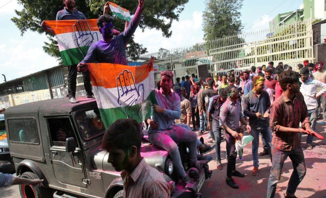 Congress Party celebrate after learning of the initial poll results of Punjab assembly...