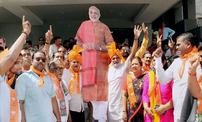 BJP supporters celebrating the party\'s victory in UP and Uttarakhand Assembly polls in Surat...
