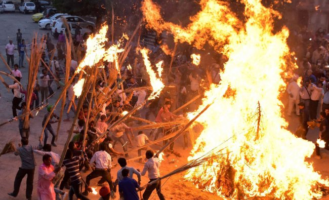 Devotees during the traditional \'Holika Dahan\' at City Palace in Jaipur on Sunday...