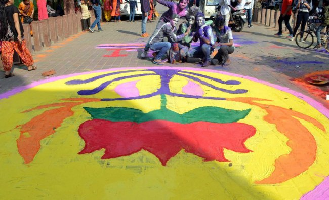 BJP supporters drawing a rangoli of lotus flower at the eastern gate of Taj Mahal in Agra...