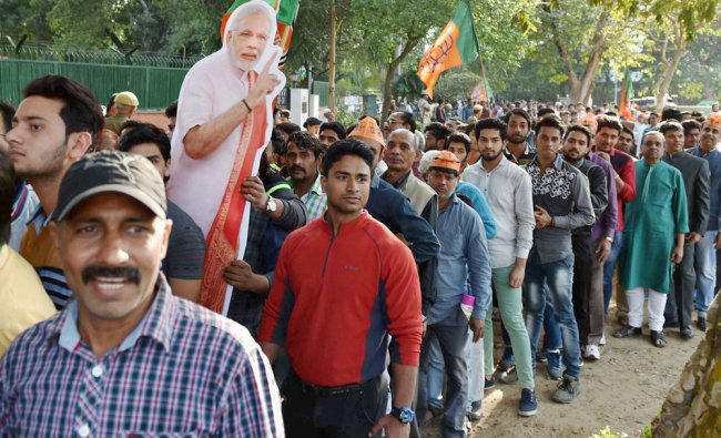 BJP workers standing in a queue to enter party headquarter to celebrate victory...