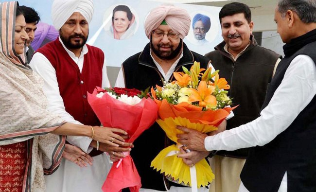 PPCC Chief Captain Amarinder Singh being welcomed by AICC general secretary in-charge of Punjab...