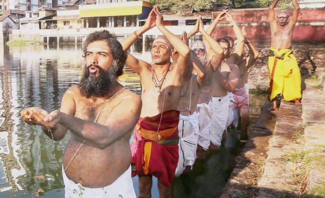 Devotees perform \'VarunaJapam\' for rains near Thali Balasubrahmanya temple pond in Kozhikode...
