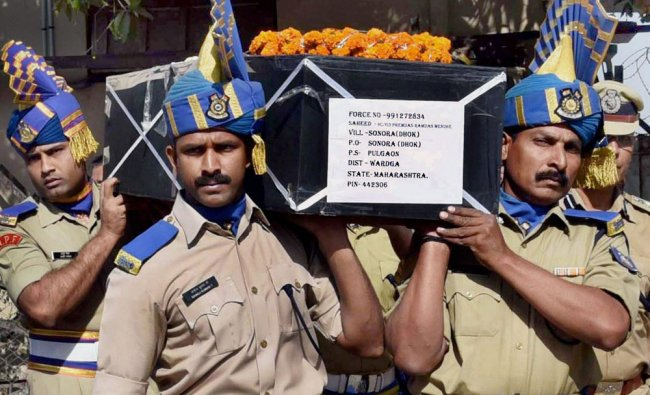 CRPF jawans carrying the coffin of H C Premdas Mendhe, killed in an ambush by Naxals in Sukma...