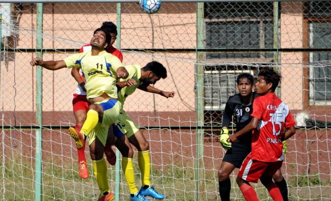 Punjab and Railways players in action in the Santosh Trophy football match at Navelim, Goa...