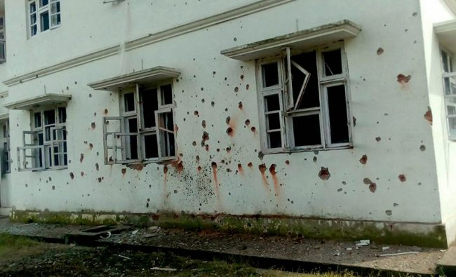 Marks of mortar shells are seen on the wall of Chakkan Da Bagh building after shelling...