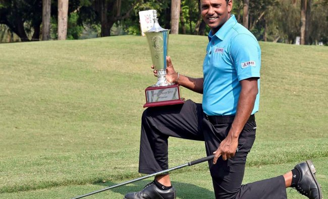 Indian Golfer SSP Chawrasia poses with the winning trophy after winning the Indian Open 2017...