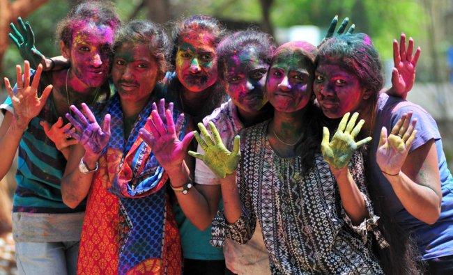 Students celebrates the festival of colour holi, at Maharani\'s Science College for Women in Mysuru..