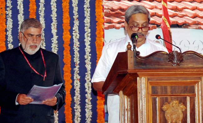 BJP leader Manohar Parrikar taking oath as Goa\'s new Chief Minister at a swearing-in ceremony in ...