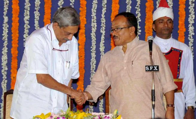 Goa\'s new Chief Minister Manohar Parrikar being greeted by his predecessor Lakshmikant Parsekar ...
