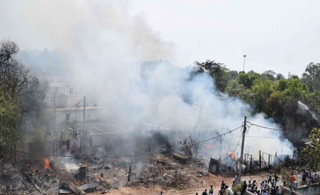 Smoke rises from the fire in a slum that gutted over 100 huts at Punaichak in Patna...