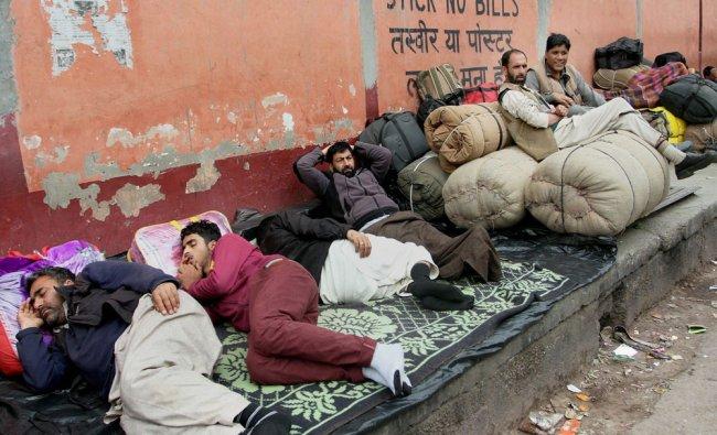 Stranded Kashmiri passengers wait for reopening of Jammu-Srinagar highway in Jammu on Thursday...