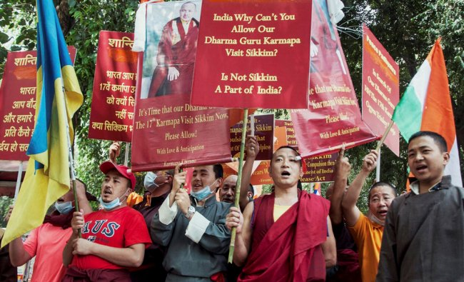 Monks from Sikkim protest outside the BJP headquarters in New Delhi demanding that the Centre ....