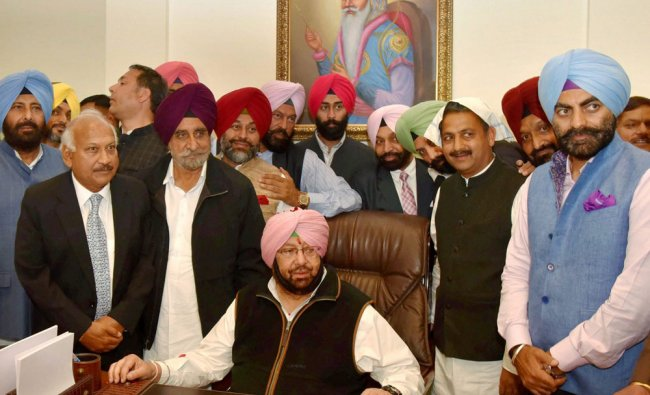 Punjab\'s new Chief Minister Captain Amarinder Singh assuming the charge of office in Chandigarh on..